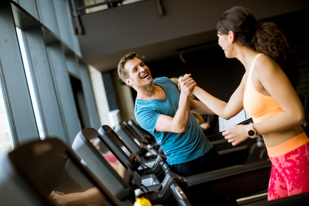 Close up of woman with trainer working out on treadmill in gym Premium Photo