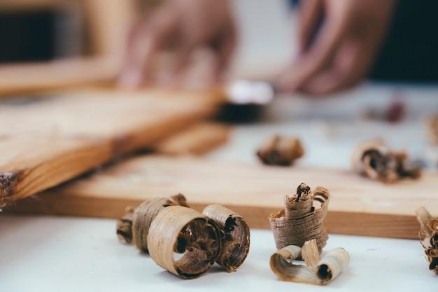 Close up of wood shavings on the carpenter's workbench. Premium Photo