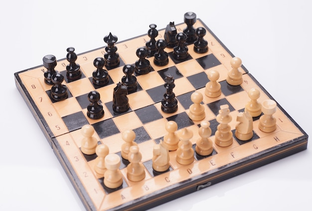Close up wooden chess pieces on board Premium Photo