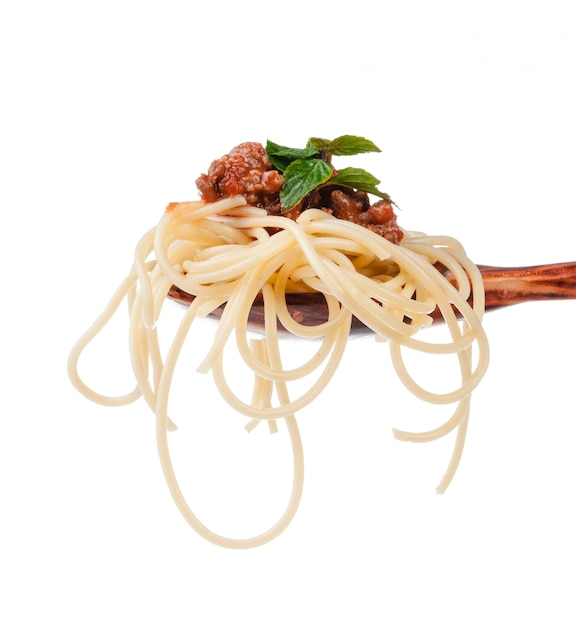 Close up of wooden cooking spoon with homemade traditional italian pasta Premium Photo