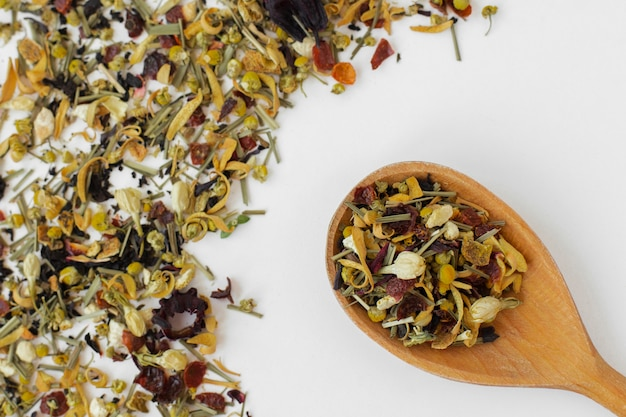 Close-up wooden spoon with tea herbs Free Photo