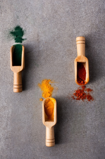 Colorful Spoons: Close-up Wooden Spoons With Colorful Spices Photo