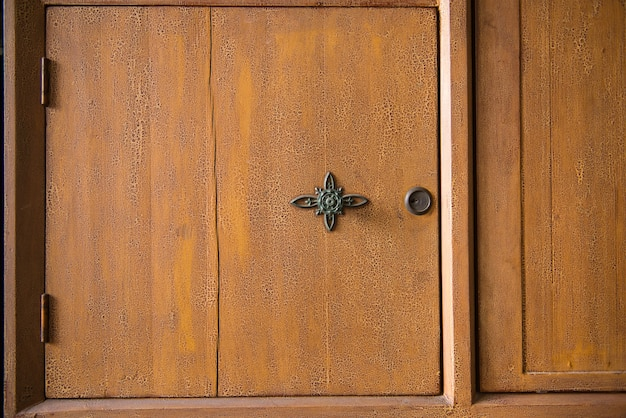 Close-up of wooden wardrobe with knob Free Photo