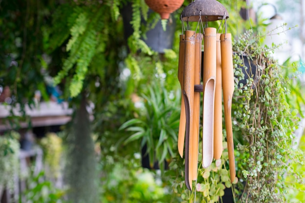 Close up on a wooden wind chime Premium Photo