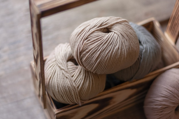 Close up of wool knitting on wooden background Free Photo