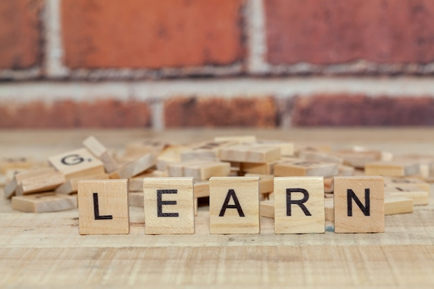Close up of word learn on wood block Premium Photo