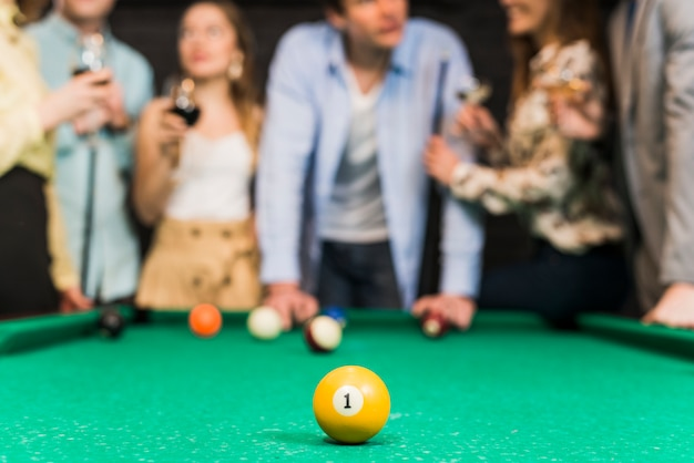 Close-up of yellow billiard ball with one number on snooker table Free Photo