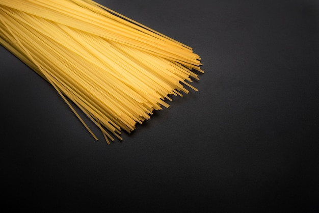 Close-up of yellow long spaghetti pasta on kitchen worktop Free Photo