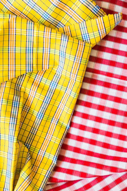 Close-up of yellow and red classical checkered textile fabric Free Photo
