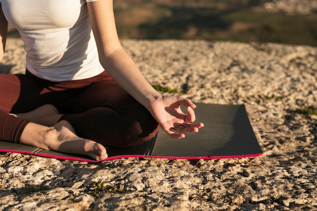 Close-up yoga general pose on mat Free Photo
