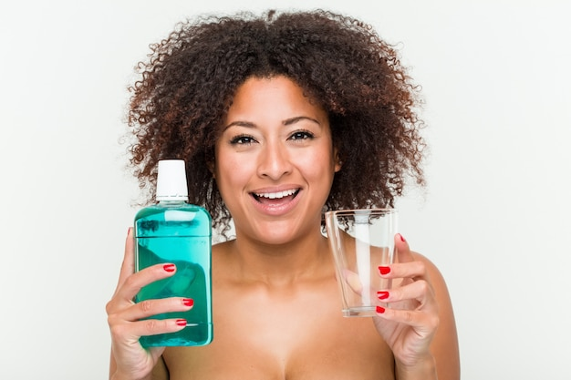 Close up of a young african american woman holding a mouthwash Premium Photo