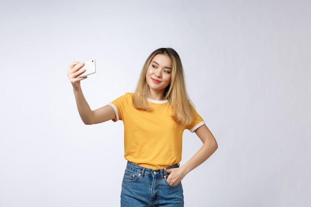 Close-up of young asian beautiful woman taking selfie Premium Photo