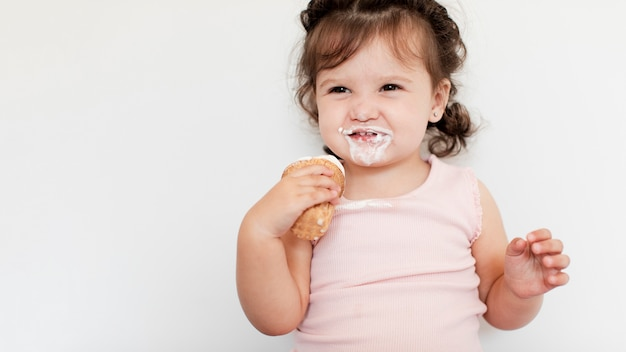 Close-up young girl eating ice cream Free Photo
