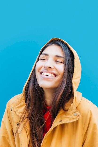 Close-up of young laughing woman wearing hoodie Free Photo