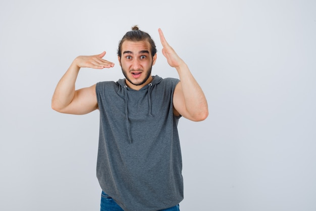 Close up on young man gesturing isolated Free Photo