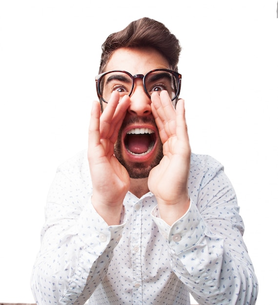 0eb4eb8a0a6 Close-up of young man with glasses screaming Free Photo