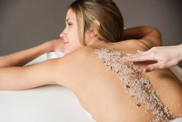 Close-up of a young woman having exfoliation treatment in spa Free Photo