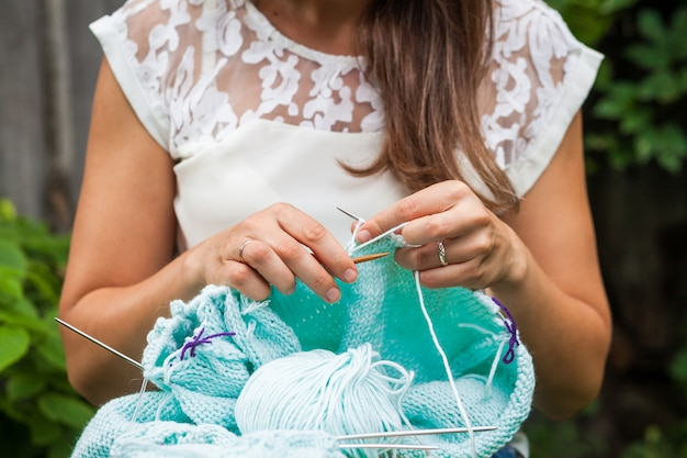 Close up of young woman knit Premium Photo