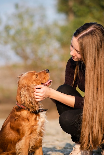 Close-up young woman in love with her dog Free Photo
