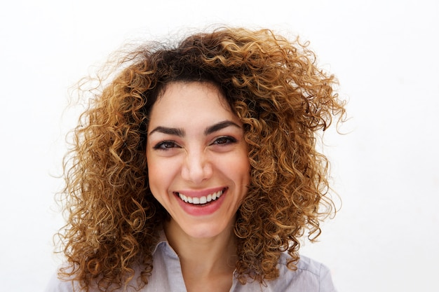 Close Up Young Woman With Curly Hair Smiling Abasing White