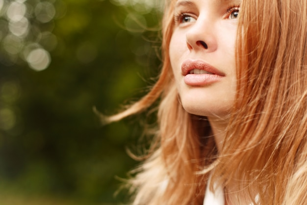 Close-up of a young woman with a deep look Free Photo
