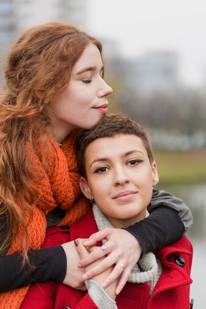 Close-up young women together in love Free Photo