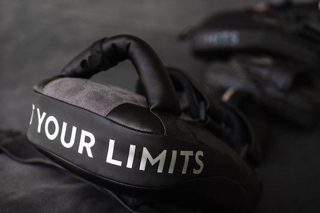 Close up of your limits word on black boxing and kicking practice pad. Premium Photo