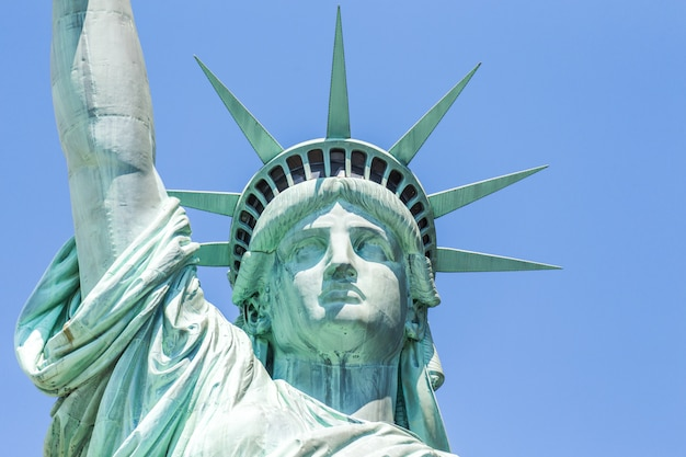 Close view of the statue of liberty over blue sky Premium Photo