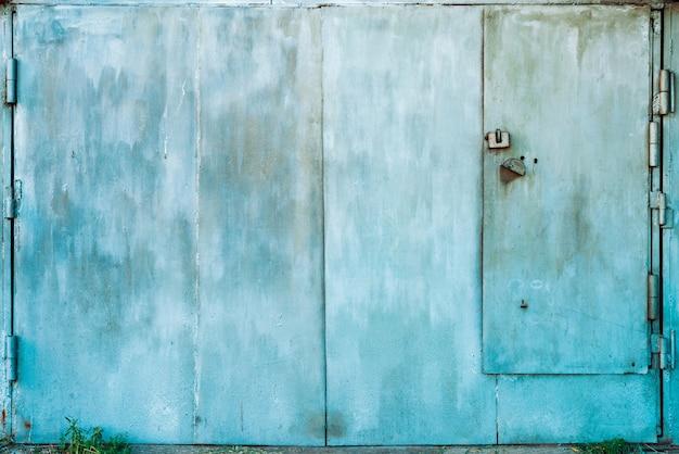 Closed imperfect rust metallic garage gate close-up. Premium Photo