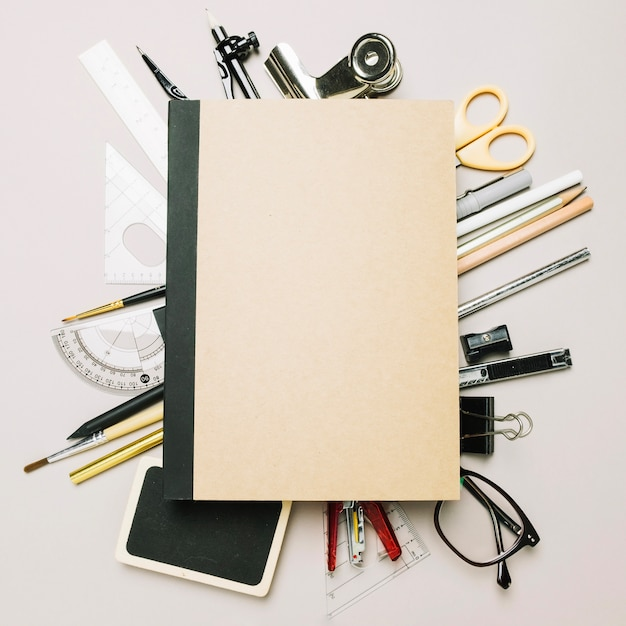 Closed notebook on office supplies Free Photo