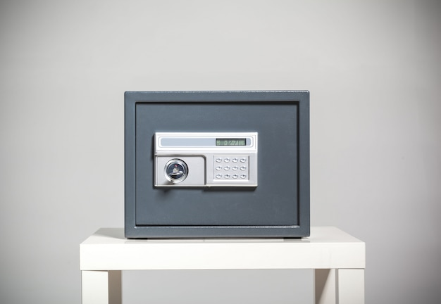 Closed safe on grey background Premium Photo
