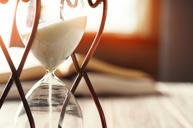 Closed up of sandglass or hourglass Premium Photo
