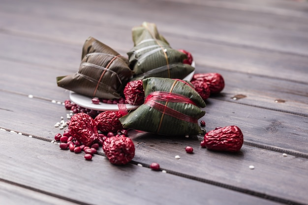 Closed zongzi with red fruits Free Photo