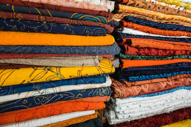 Closeuo of colorful textile on fabric shop Free Photo