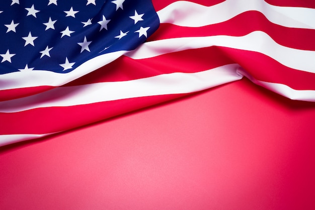 Closeup of american flag on red background. Premium Photo