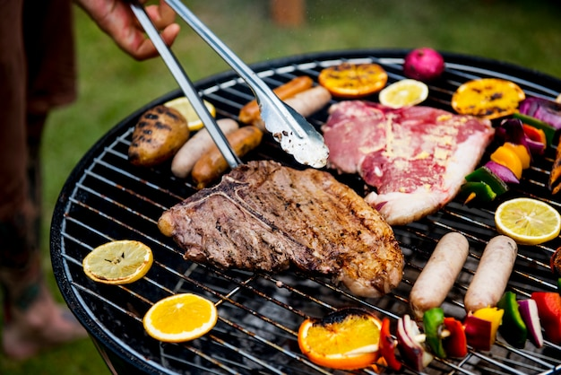 Closeup of barbecues steaks on the charcoals grill Premium Photo