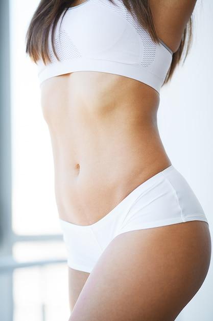 Closeup of beautiful slim woman body with sexy buttocks, big ass Premium Photo