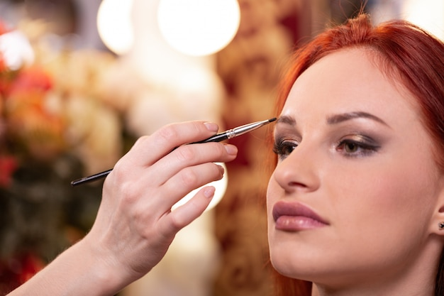 Closeup of beautiful young woman face with beauty makeup Premium Photo