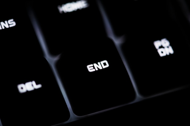Closeup of a black computer keyboard and end button Free Photo