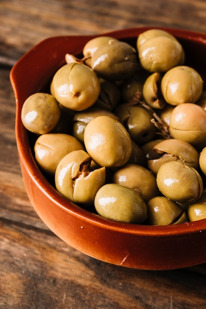 Closeup bowl of olives Free Photo
