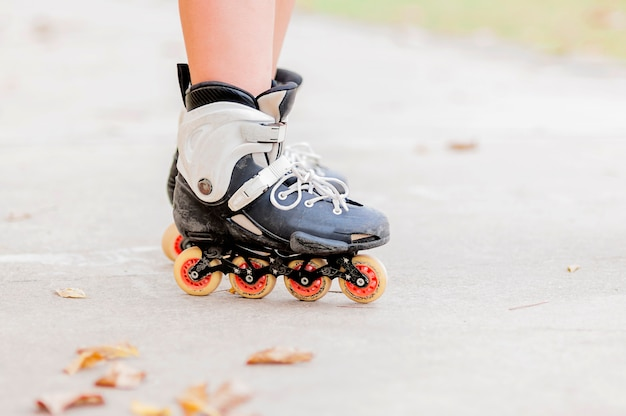 Closeup of boy is standing with roller blade, selective focused. Free Photo