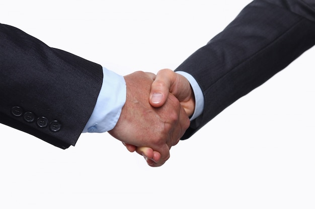 Closeup of a business handshake , isolated on white background Premium Photo
