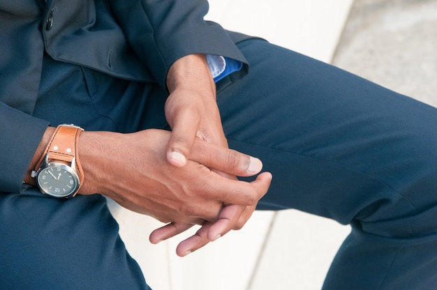 Closeup of businessman clasped hands Free Photo