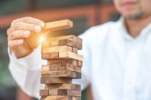 Closeup of businessman making a pyramid with empty wooden cubes Premium Photo