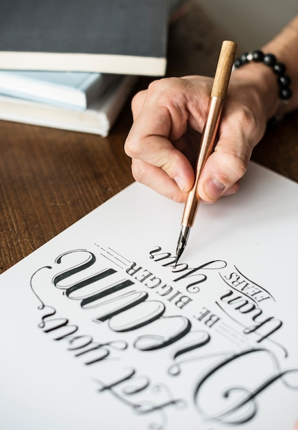 Closeup of a calligrapher working on a project Premium Photo