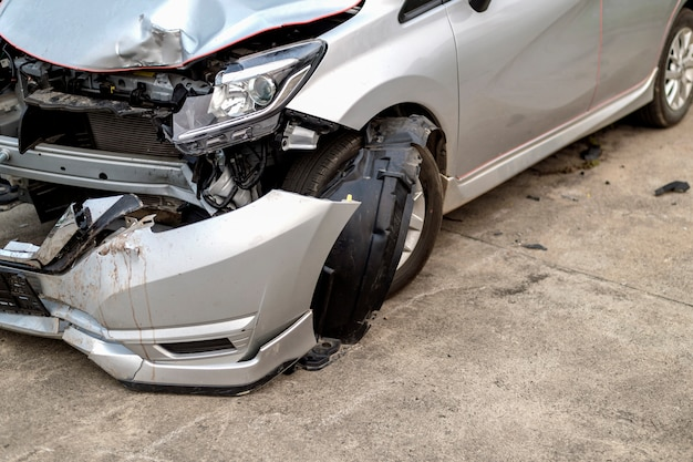 Closeup car in front has been damaged by accident Premium Photo