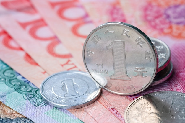 Closeup china yuan coins and banknote for exchange  saving and investment concept. Premium Photo
