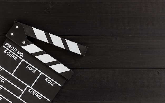 Closeup clapboard on black wood Premium Photo