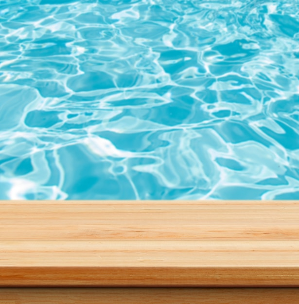 Closeup clear wooden studio background beside swimming pool - well use for present products. Free Photo