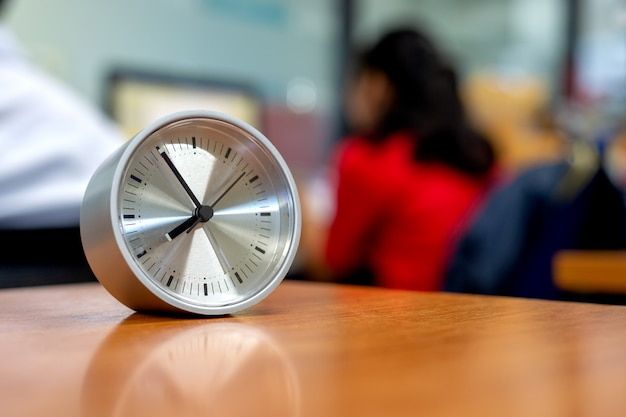 Closeup clock on the desk in the office Premium Photo